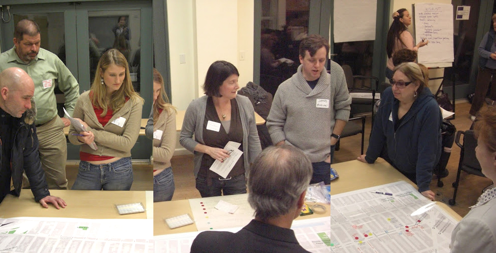 Attendees of the FOFA planning session gather around the GIS map to identify key issues.